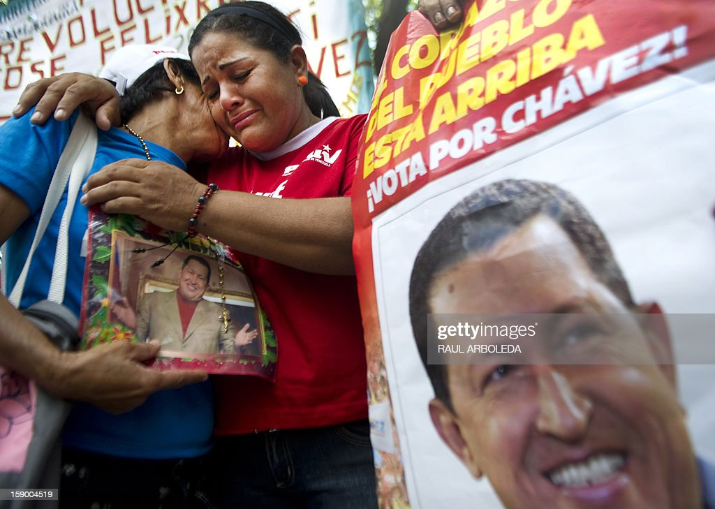 Supporters of Venezuelan President Hugo Chavez gather outside the National Assembly in Caracas on January 5, 2013. Venezuelan lawmakers gathered Saturday for a key leadership vote and debate as President Hugo Chavez's battle with cancer appeared almost certain to delay his swearing-in for a new six year term. AFP PHOTO/Raul Arboleda