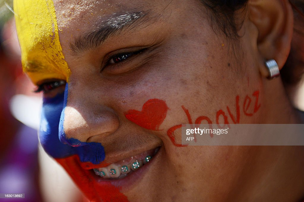 Supporters of Venezuelan President Hugo Chavez rally to show their support in Caracas on March 3, 2013. Chavez still in charge and mulling political, social and economic policies even as he receives a new round of chemotherapy, his vice president said Saturday. AFP PHOTO/Leo RAMIREZ