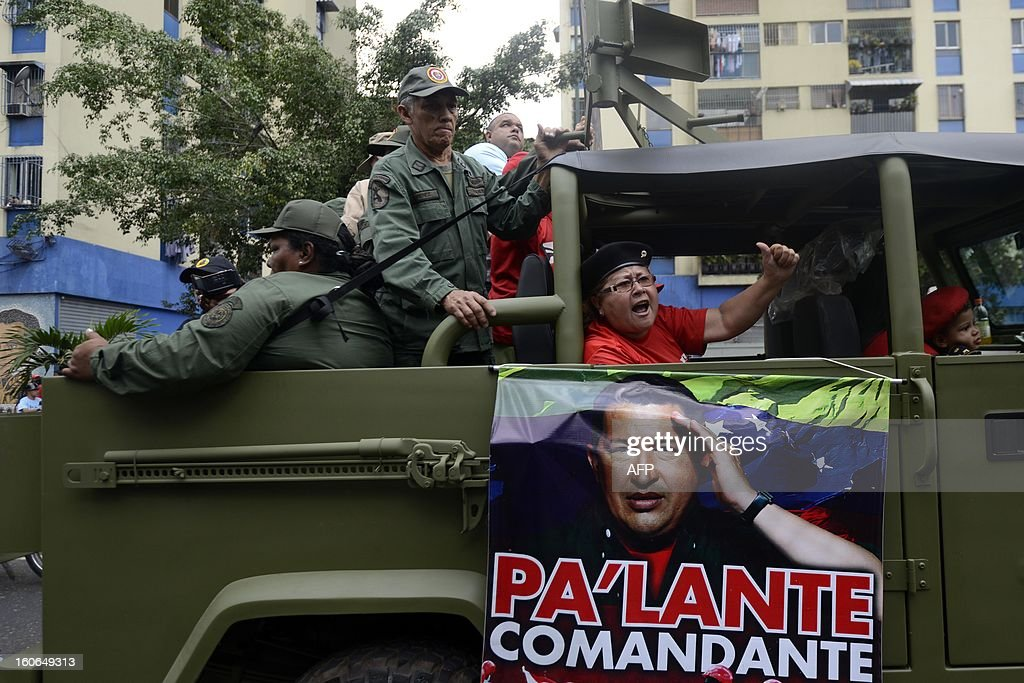 Supporters of Venezuelan President Hugo Chavez, take part in a march to conmemorate the 1992 failed coup led by Chavez, who was an army lieutenant colonel, against then president Carlos Andres Perez, in Caracas, on February 4, 2013. Ailing President Hugo Chavez, who had cancer surgery in December, is doing much better and recovering, Cuban leader Fidel Castro said in remarks published Monday. AFP PHOTO/Leo RAMIREZ