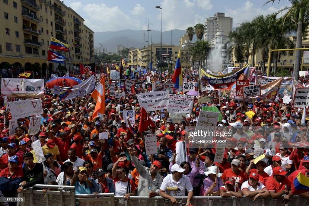 Supporters of Venezuelan President Nicolas Maduro attend a May Day rally in Caracas on May 1 2014 AFP PHOTO/FEDERICO PARRA