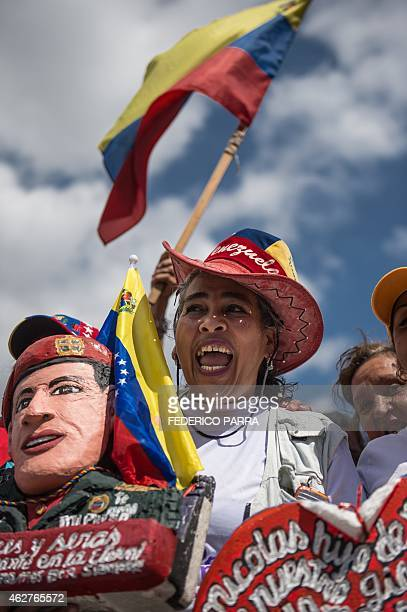Supporters of Venezuelan President Nicolas Maduro cheer during the a military parade to commemorate the 23rd anniversary of former Venezuelan...
