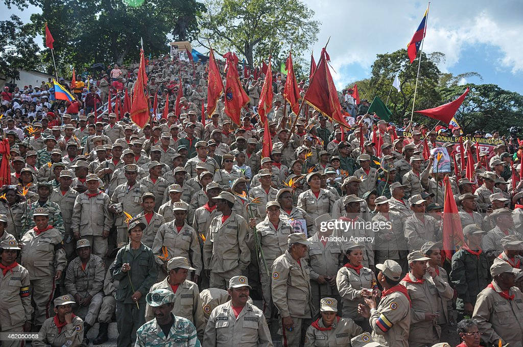 Supporters of Venezuelan President <a gi-track='captionPersonalityLinkClicked' href=/galleries/search?phrase=Nicolas+Maduro&family=editorial&specificpeople=767093 ng-click='$event.stopPropagation()'>Nicolas Maduro</a> participate in the March of the Undefeated to commemorate the 57th anniversary of the overthrow of the Marco Perez Jimenez dictatorship in Caracas, Venezuela on January 23, 2015. They remembered the people persecuted, tortured and missing by the dictatorship and the years after when the 'fourth republic' was in power.