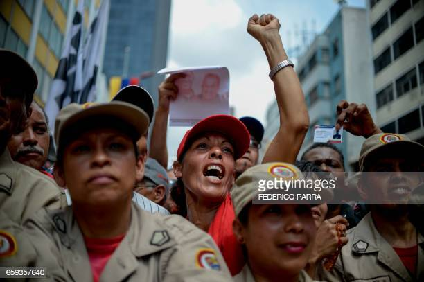 TOPSHOT Supporters of Venezuelan President Nicolas Maduro take part in a rally against the secretary general of the Organization of American States...