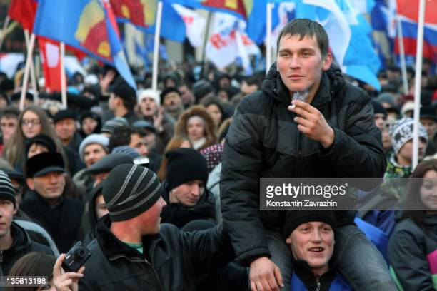 Supporters of Vladimir Putin's United Russia's Party along with activists of the proKremlin youth movement Young Guard of United Russia rally in...