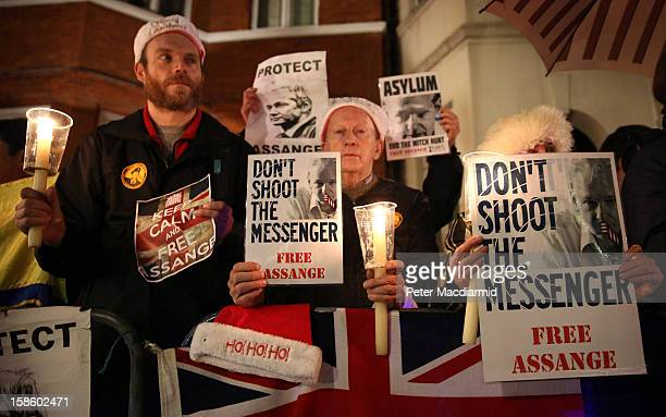 Supporters of Wikileaks founder Julian Assange wait for him to speak at the Ecuadorian Embassy on December 20 2012 in London England Mr Assange has...