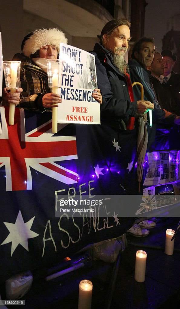 Supporters of Wikileaks founder Julian Assange wait for him to speak at the Ecuadorian Embassy on December 20, 2012 in London, England. Mr Assange has been living in the embassy since June 2012 in an attempt to avoid extradition to Sweden where he faces allegations of sexual assault.
