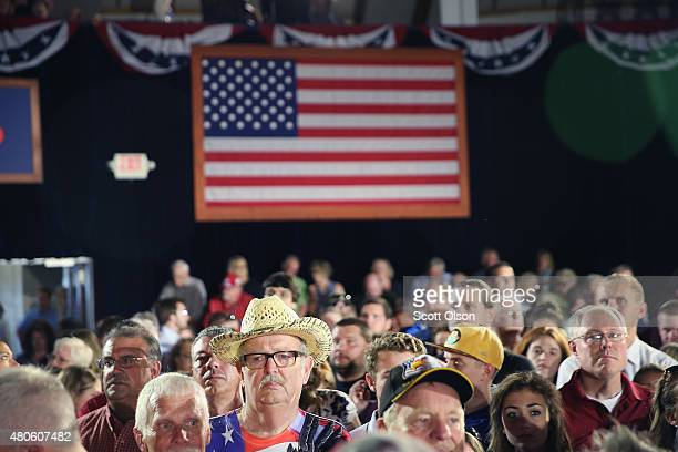 Supporters of Wisconsin Governor Scott Walker wait at the Waukesha County Expo Center for him to announce that he will seek the Republican nomination...