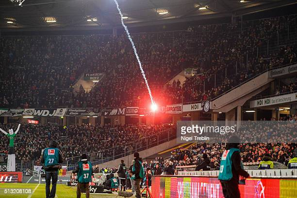 Supporters of Wolfsburg burn flares during the Bundesliga match between Hannover 96 and VfL Wolfsburg at HDIArena on March 1 2016 in Hanover Germany