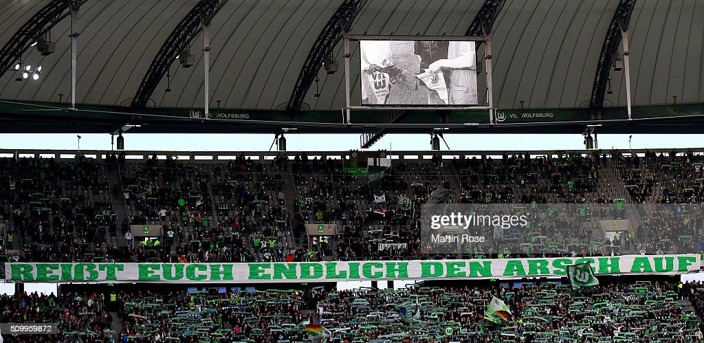 Supporters of Wolfsburg showing a banner before the Bundesliga match between VfL Wolfsburg and FC Ingolstadt at Volkswagen Arena on February 13, 2016 in Wolfsburg, Germany.