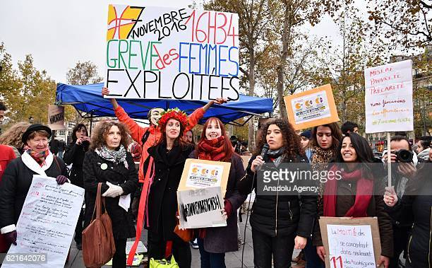 Supporters of women rights unions hold banners during a demonstration for equal pay between men and women at Republique Square in Paris on November 7...