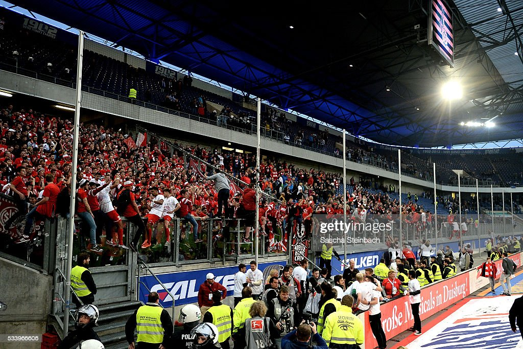 Supporters of Wuerzburg celebrate their team after winning the 2. Bundesliga playoff leg 2 match against MSV Duisburg at Schauinsland-Reisen-Arena on May 24, 2016 in Duisburg, Germany.