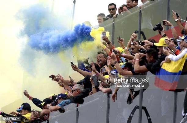 Supporters of Yamaha biker Italian Valentino Rossi cheer duringt the podium ceremony of the MotoGP race of the Argentina Grand Prix at Termas de Rio...