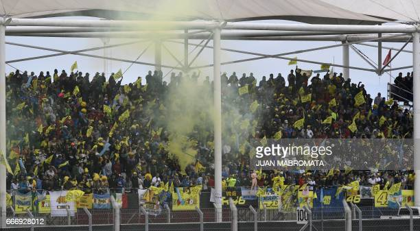Supporters of Yamaha biker Valentino Rossi of Italy cheer before the start of the MotoGP race of the Argentina Grand Prix at Termas de Rio Hondo...