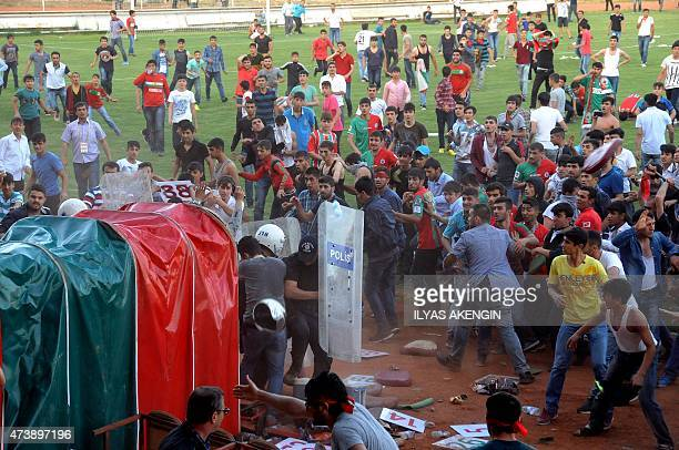 Supporters of Yeni Diyarbakirspor clash with Turkish riot police after a penalty decision by the referee in favor to Denizli Buyuksehir Belediyesi...