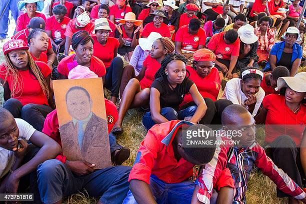 Supporters of Zimbabwe's main opposition party Movement for Democratic ChangeTsvangirai they attend a gathering during a 'No Reforms No Elections'...