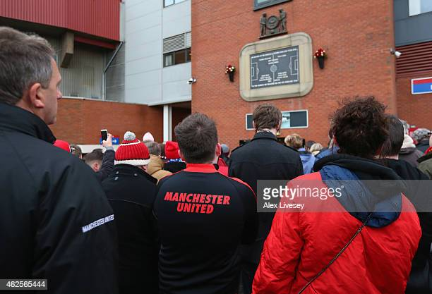 Supporters pay tribute to the Munich Air Disaster at the Munich Memorial outside Old Trafford prior to the Barclays Premier League match between...