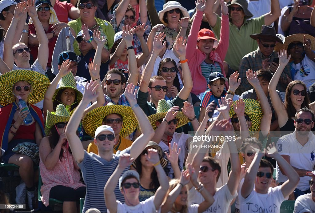 Supporters perform a Mexican wave during a men's singles match between Slovenia's Blaz Kavcic and France's Jo-Wilfried Tsonga on day six of the Australian Open tennis tournament in Melbourne on January 19, 2013.