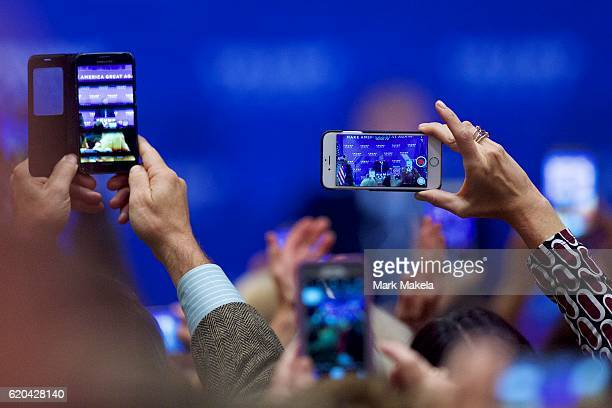 Supporters photograph Republican Presidential nominee Donald J Trump during a rally at the Double Tree by Hilton Valley Forge November 1 2016 in King...