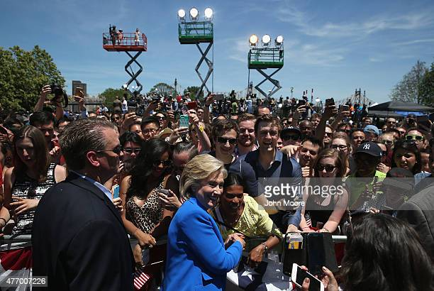 Supporters pose for photos with Democratic Presidential candidate Hillary Clinton after she officially launched her presidential campaign on June 13...