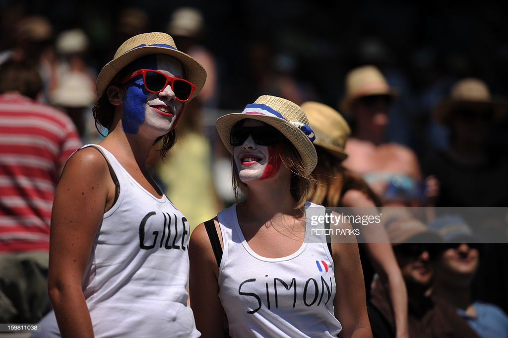 Supporters prepare to cheer for France's Gilles Simon duing his men's singles match against Britain's Andy Murray on the eighth day of the Australian Open tennis tournament in Melbourne on January 21, 2013.