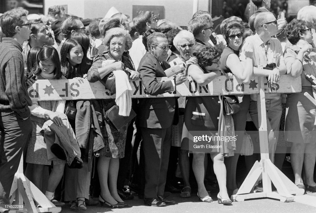 Supporters press against a barricade on Powell Street as they await President Nixon's arrival at the St Francis Hotel San Francisco California August...