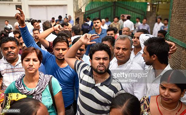 AAP supporters protest against Delhi Police outside the Nabsari Police Station after the police arrested AAP legislator Dinesh Mohaniya for allegedly...