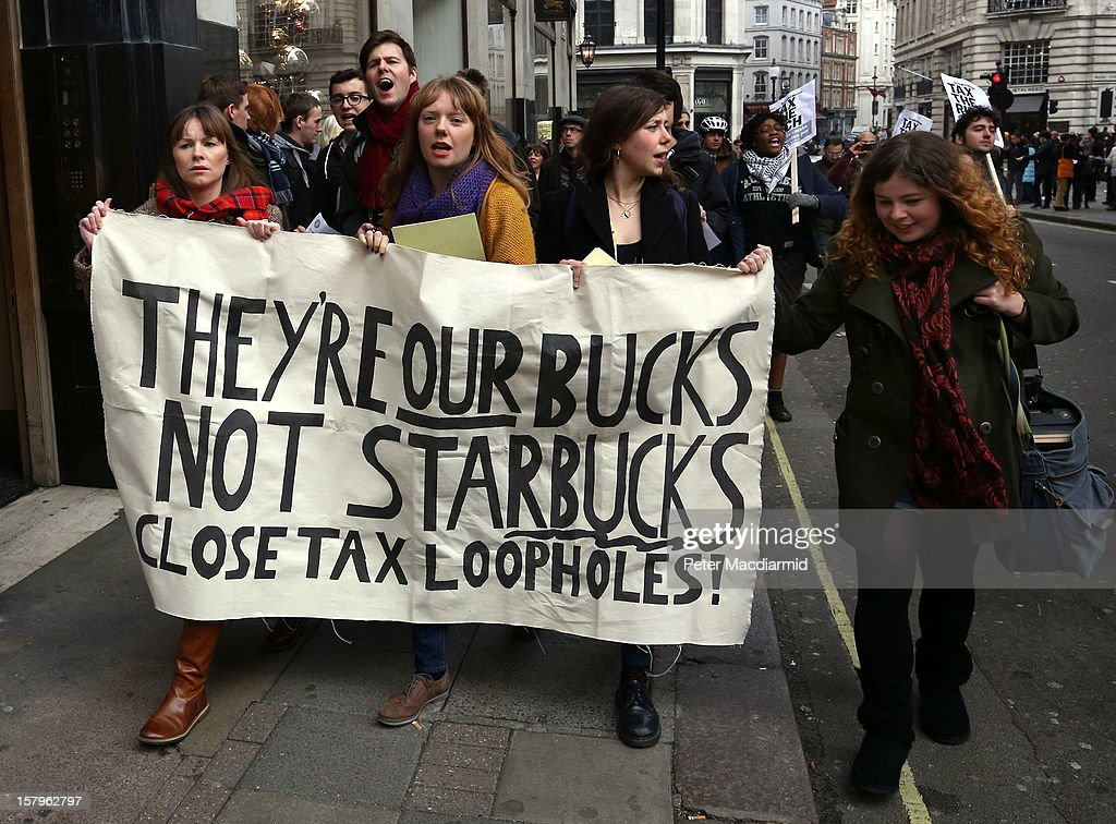 UK UNCUT supporters protest at a Starbucks coffee shop near Regent Street on December 8, 2012 in London, England. UK UNCUT are holding a day of protests at various Starbucks throughout the United Kingdom after the coffe chain were revealed to be paying almost no corporation tax.