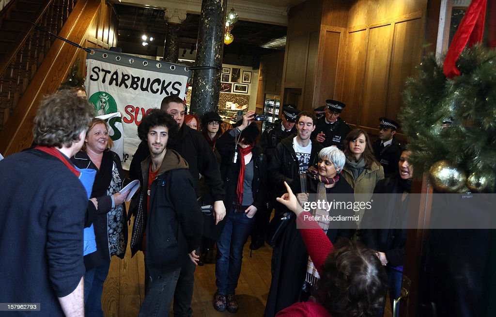 UK UNCUT supporters protest inside a Starbucks coffee shop near Regent Street on December 8, 2012 in London, England. UK UNCUT are holding a day of protests at various Starbucks throughout the United Kingdom after the coffe chain were revealed to be paying almost no corporation tax.