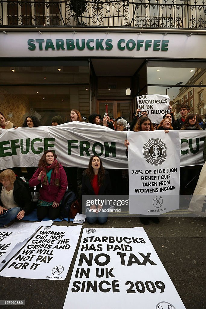 UK UNCUT supporters protest outside a Starbucks coffee shop near Regent Street on December 8, 2012 in London, England. UK UNCUT are holding a day of protests at various Starbucks throughout the United Kingdom after the coffe chain were revealed to be paying almost no corporation tax.