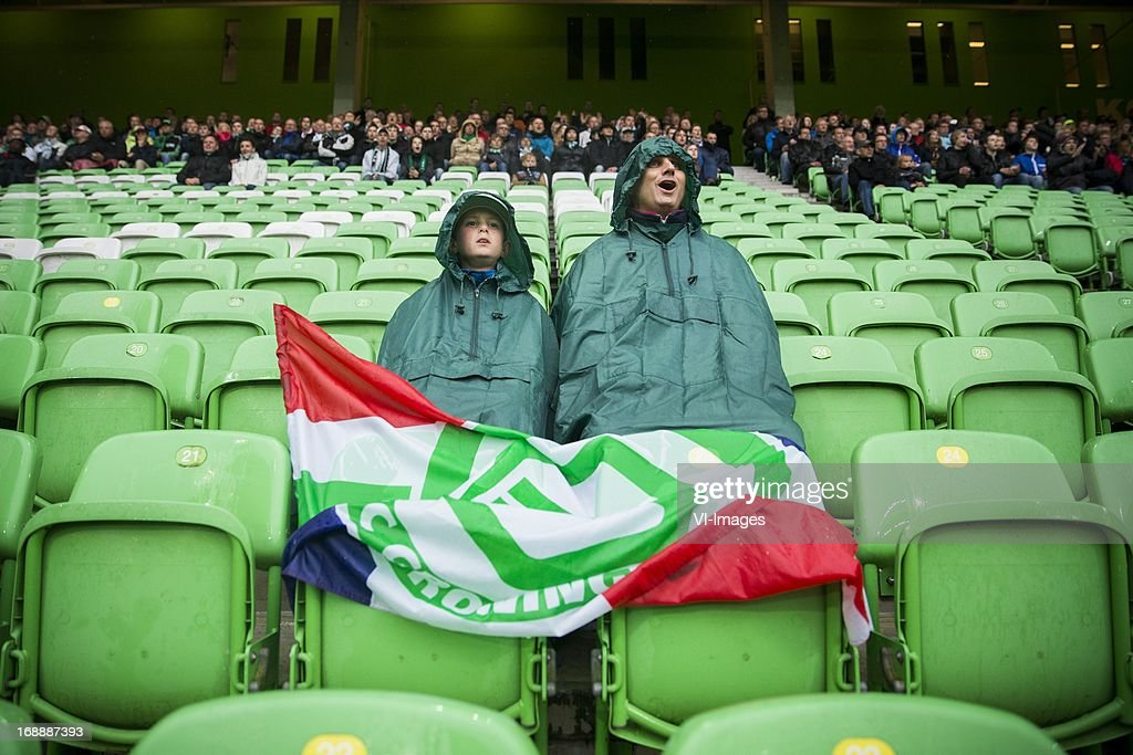 Supporters Rain FC Groningen during the Eredivisie Europa League Playoff match between FC Groningen and FC Twente on May 16, 2013 at the Euroborg stadium at Groningen, The Netherlands.