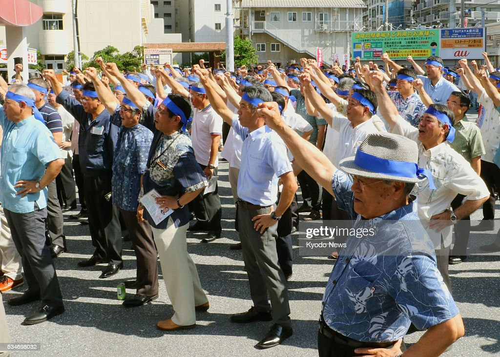 Supporters rally for a candidate in the Okinawa prefectural assembly election in Naha, the capital of the southernmost Japan prefecture, on May 27, 2016, the first day of electoral campaigning, amid tension over the arrest of a U.S. base worker over the death of a local woman.