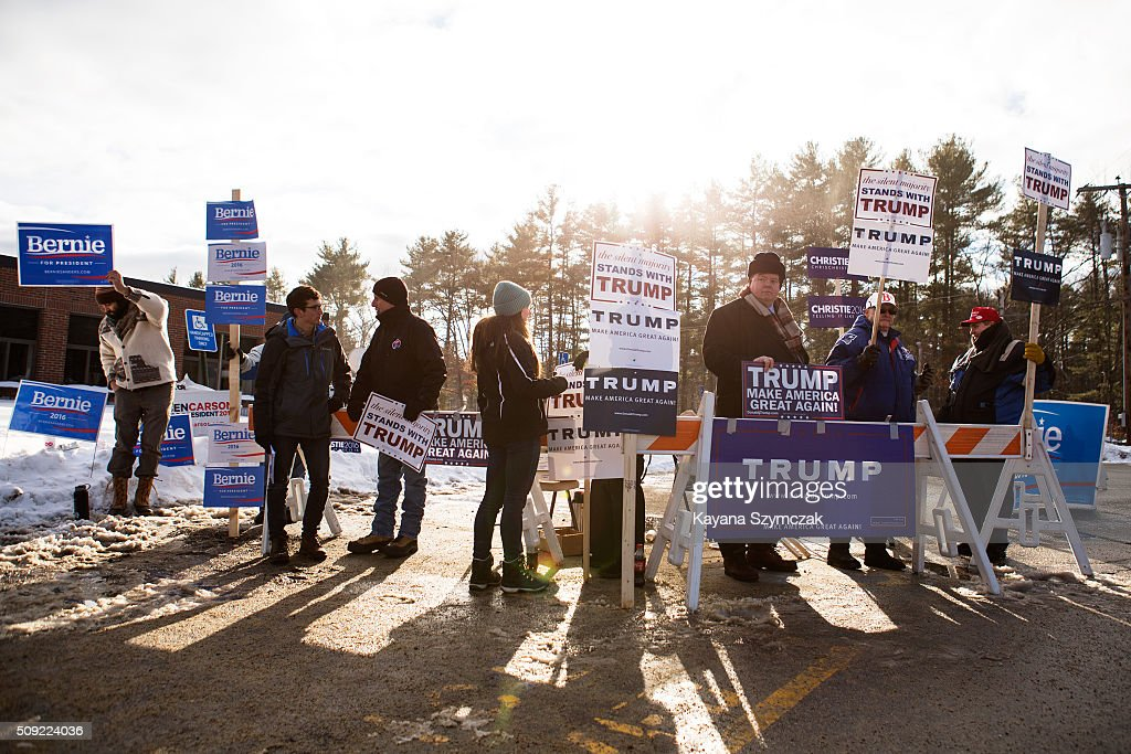 Supporters rally for their chosen candidate outside of the voting place at Merrimack High School on primary day, February 9, 2016, in Merrimack, New Hampshire. Tuesday is the 100th anniversary of the New Hampshire primary, the 'First in the Nation' test for presidential candidates from both parties.