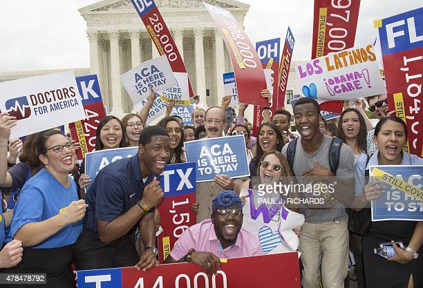 Supporters rally in front of the Supreme Court after the court's announcment of the decision affirming the Affordable Care Act on June 25 in...