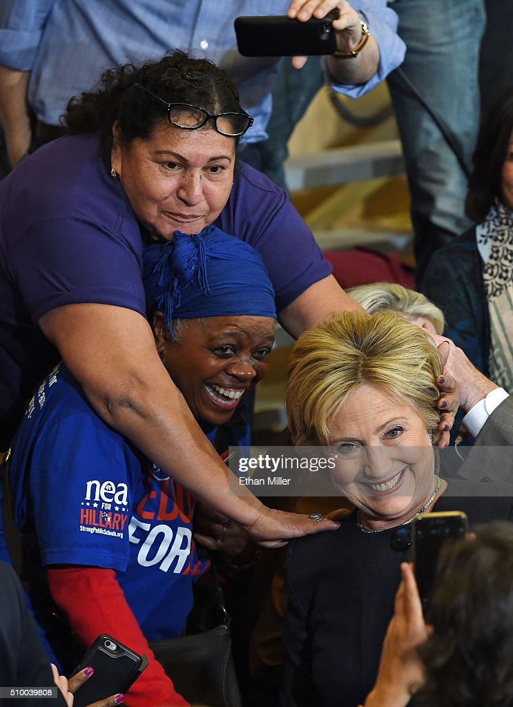 Supporters reach out to Democratic presidential candidate <a gi-track='captionPersonalityLinkClicked' href=/galleries/search?phrase=Hillary+Clinton&family=editorial&specificpeople=76480 ng-click='$event.stopPropagation()'>Hillary Clinton</a> as she takes photos after speaking during a get-out-the-caucus event on February 13, 2016 in Henderson, Nevada. Clinton is challenging Sen. Bernie Sanders for the Democratic presidential nomination ahead of Nevada's Feb. 20 Democratic caucus.