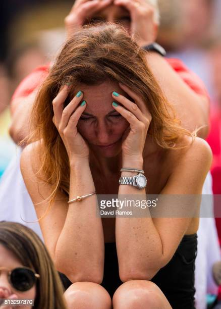 Supporters react as they watch the Gentlemen's Singles match between Any Murray of Great Britain and Sam Querrey of the United States from 'Murray's...