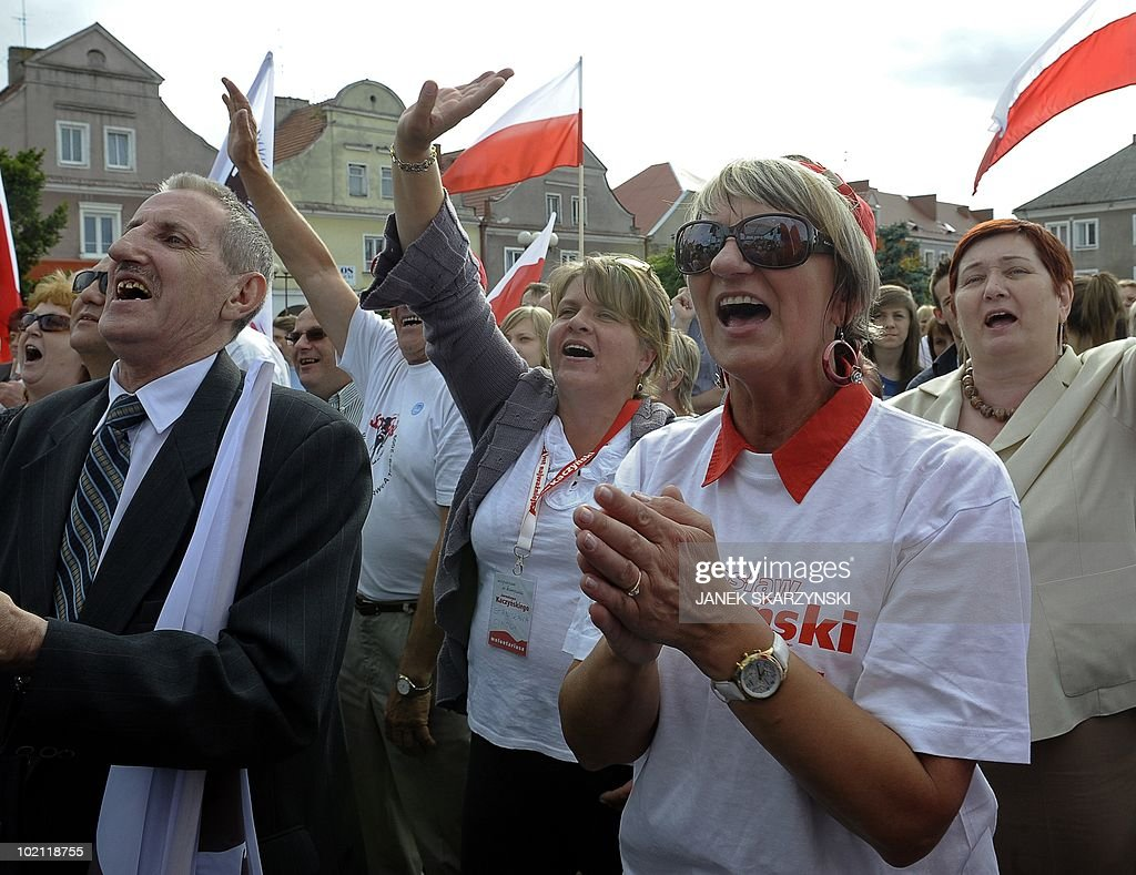 Supporters react during an electorial rally of Jaroslaw Kaczynski, leader of Poland's conservative PiS (Law and Justice) party on June 15, 2010 in Lomza. Jaroslaw Kaczynski is running for president after his twin, President Lech Kaczynski, died in a plane crash in Russia.