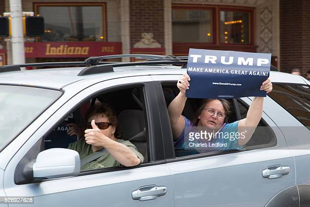 Supporters react to antiTrump protesters after a rally by Republican presidential candidate Donald Trump at the Indiana Theater on May 1 2016 in...