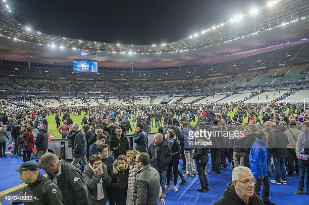 supporters run in panic on the pitch during the International friendly match between France and Germany on November 13 2015 at the Stade France in...
