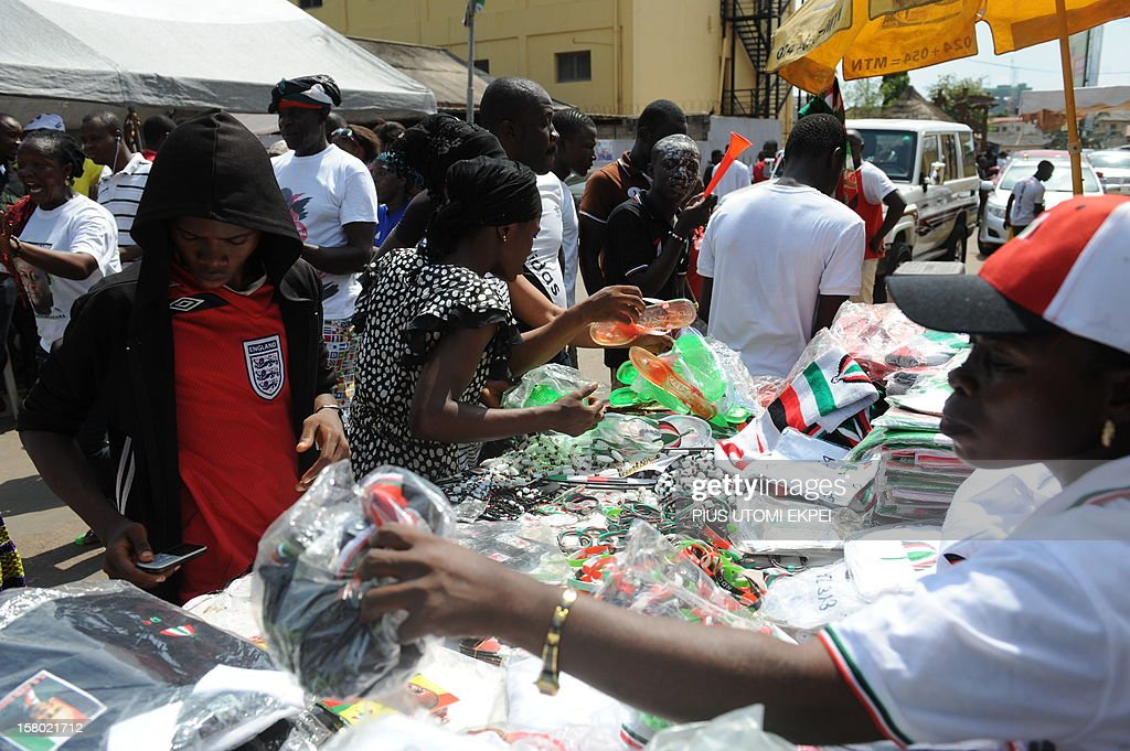 Supporters rush to buy souvenirs and emblems to celebrate at the party headquarters as news spreads of President John Mahama's imminent victory at the just concluded Ghana presidential and parliamentary elections in Accra on December 9, 2012. Supporters of the candidate of the ruling National Democratic Congress and incumbent President John Mahama have started celebrating ahead of the final declaration of results by the Election Commission headed by Dr. Afari-Gyan.