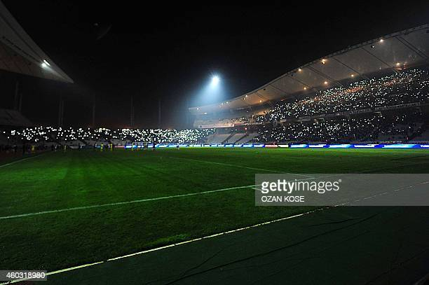 Supporters shine the lights of their mobile phones after the match was suspended following a power failure during UEFA Europa League Group C football...