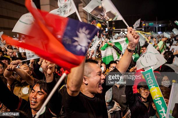 Supporters shout as they attend at DPP headquarters during Tsai Ingwen speach her election victory on January 16 2016 in Taipei Taiwan Tsai Ingwen...