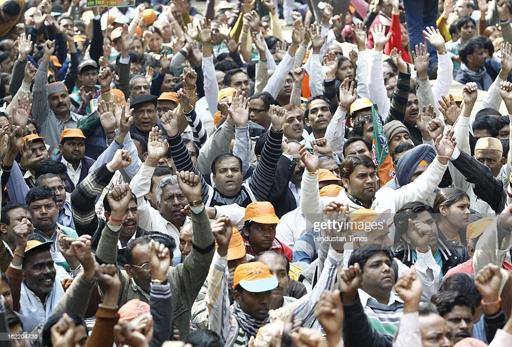 BJP supporters shouts slogans at a rally in protest against Union Home Minister Sushil Kumar Shinde's remarks linking saffron terror to BJP and RSS, at Jantar Mantar on February 20, 2013 in New Delhi, India. Stepping up the attack on Shinde ahead of the Budget session the BJP president said that the comments were part of a conspiracy to divide the nation for votebank politics and demanded an apology from Home Minister.
