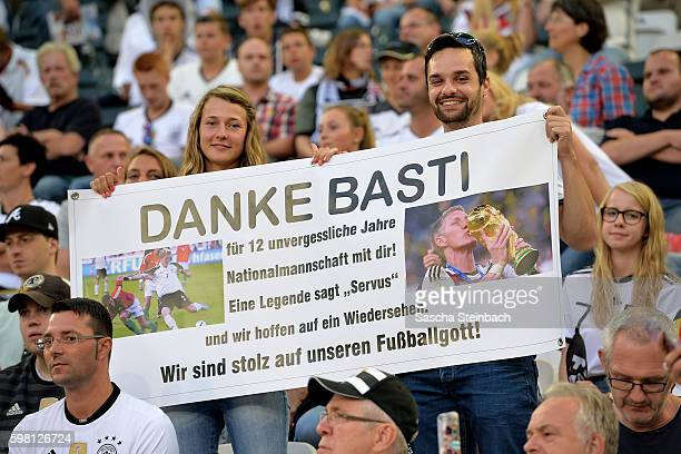 Supporters show their banners for Bastian Schweinsteiger during the international friendly match between Germany and Finland at BorussiaPark on...