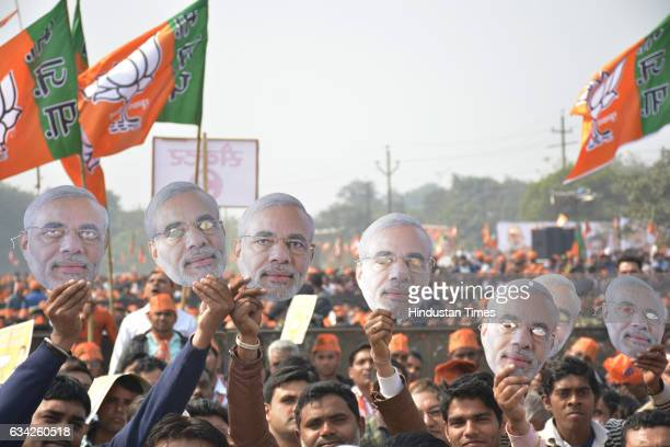 BJP supporters showing Modi mask during an election campaign rally of Prime Minister Narendra Modi on February 8 2017 in Ghaziabad India Prime...