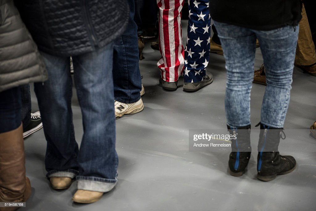 Supporters stand at campaign rally for Republican Presidential Candidate Donald Trump on April 6, 2016 in Bethpage, New York. The rally comes ahead of the April 15 New York primary.