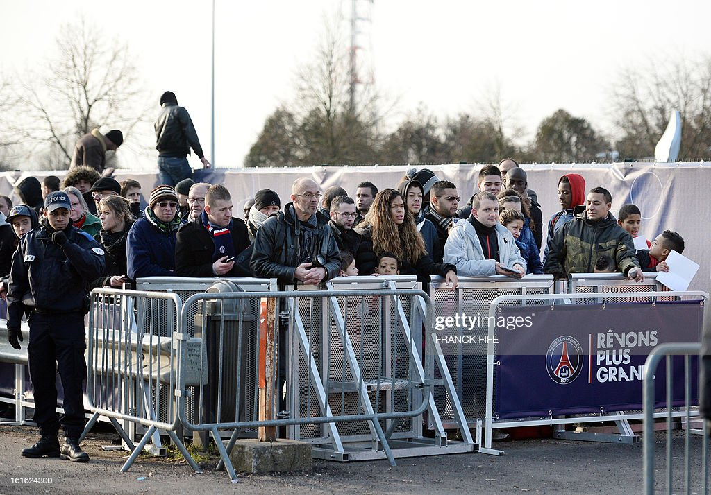 Supporters stand on February 13, 2013 putside the club's Camp des Loges training center in Saint-Germain-en-Laye, near Paris. David Beckham began to settle in to his new surroundings on Wednesday afternoon, as he trained at his new club Paris Saint-Germain's base for the first time. The arrival of the 37-year-old Englishman at the Camp des Loges training ground in the French capital's western suburbs attracted the kind of media circus that only somebody of his superstar status can.