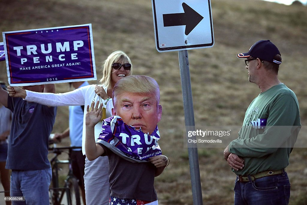 Supporters stand on the side of the road as Republican presidential nominee Donald Trump's motorcade leaves a campaign rally in the Rodeo Arena at the Jefferson County Fairgrounds October 29, 2016 in Golden, Colorado. The Federal Bureau of Investigation announced Friday it discovered emails pertinent to the closed investigation of Democratic presidential nominee Hillary Clinton's private email server and are looking to see if they improperly contained classified information. Trump said 'I think it's the biggest story since Watergate.'