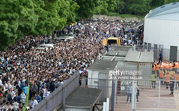 Supporters stand outsite the gates of the ChabanDelmas stadium before the French L1 football match between Bordeaux and Nantes the last match of the...
