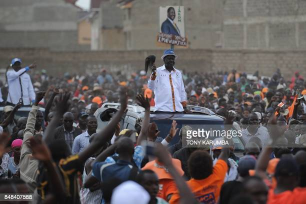 Supporters surround Kenya's main political opposition National Super Alliance presidential flagbearer Raila Odinga arriving on motorcade to a...