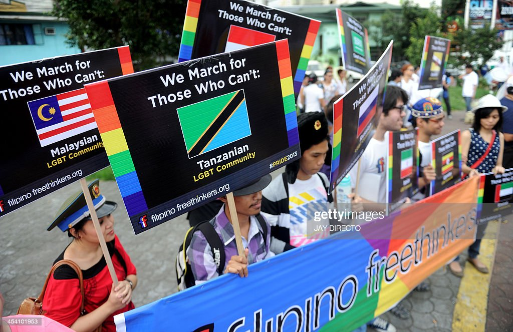 Supporters take part in an annual gay pride march calling for equal rights for lesbian, gay, bisexual and transgender people in Manila on December 7, 2013. The Philippines made headlines when it held the first gay pride march in Asia in 1994 and a few years ago became the first country in Southeast Asia to have an official gay political party. AFP PHOTO / Jay DIRECTO